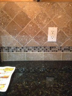 New travertine tile backsplash with glass mosaic accent