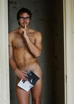Hunky cute nude nerd with hairy chest and glasses