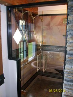 Custom french-door style shower enclosure by www.glassworksvt.com