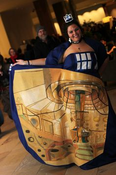 This is cosplayer Sasha Trabane sporting a TARDIS dress with the TARDIS interior cleverly painted by Andy Coyle in a fabric inset.