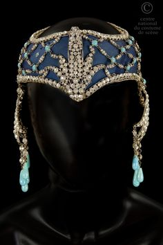Headdress with navy blue chiffon, trimmed with rhinestones and turquoise stones. Collection: Opéra National de Paris.