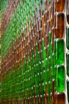 "Million Bottle Temple Detail    Detail of one of the walls of Wat Pa Maha Chedio Kaew, more commonly know as ""The Million Bottle Temple"" or ""Wat Lan Kuad"" in Thai. This Buddhist temple about 300 miles from Bangkok is decorated with more than a million recycled bottles.  By Mark Fischer"