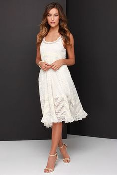 Whether youre walking along a sandy beach, or meandering through a meadow the Hazel Moonlit Meadow Cream Lace Midi Dress will be your favorite frock! A scoop neckline tops this loose-fitting sleeveless dress, with dotted lace punctuated by lace insets around the bodice and skirt. Ruffled hem. Detachable slip lining with adjustable straps. Lined to mid-thigh. 70% Cotton, 30% Nylon. Dry Clean Only. Imported.