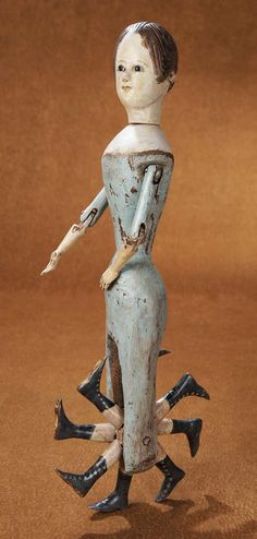 Extremely Rare Early 19th-century Wooden Doll with Eight-Leg Walking Body