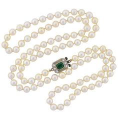 Creamy white pearls and a dazzling diamond and emerald clasp give timeless appeal to this 1920s Art Deco era necklace. Perfect for a bridal event, a special occasion, or a even stylish everyday piece!