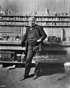 1906: Full-length portrait of American inventor Thomas Alva Edison (1847-1931) standing in his laboratory, Menlo Park, New Jersey. Beakers and jars line the shelves.