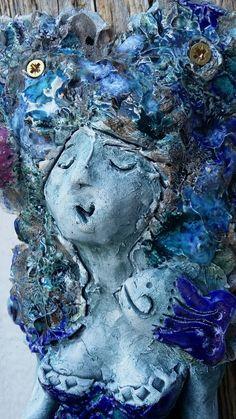 Havfrue i keramikk