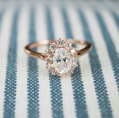 A pretty halo set diamond engagement ring with a rose gold setting.