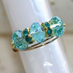 """""""Trinity Ring"""" with Tropical Blue Topaz Crystal Ring in 18ktgp Sizes 5 - 10 by Maru"""