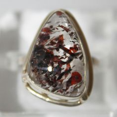 A personal favourite from my Etsy shop https://www.etsy.com/listing/499844307/rare-red-fire-quartz-lepidocrocite-ring