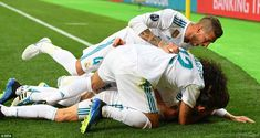 Bale's Madrid team-mates bundle on top of the match-winner after netting one of the great ...