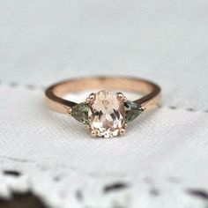 Together the graceful curves of a tapered band and elongating shape of an oval morganite make a ring that is extremely flattering on the hand. The stones for this ring were specifically cut for this s