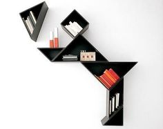 Give your indoors the charm of a geometric design in the form of these Tangram Shelves by Lago Italy. You can choose to design these shelves in the form Creative Bookshelves, Modern Bookshelf, Bookshelf Design, Cool Shelves, Bibliotheque Design, Tangram, Geometric Shelves, Modular Walls, Funky Home Decor