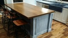 Wormy maple island top with medium walnut stain.  Handcrafted by Northeast Furniture Studio.