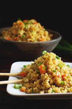 Easy Low-Carb Cauliflower Fried Rice Recipe on a plate with chop sticks