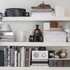 A chic bookshelf styling with black and white colour scheme + some pop neutral colour objects. Bookshelf Styling, Bookshelves, Interior Styling, Interior Design, Scandinavian Interior, Home Decor Styles, Interior Inspiration, Interior And Exterior, Shelving