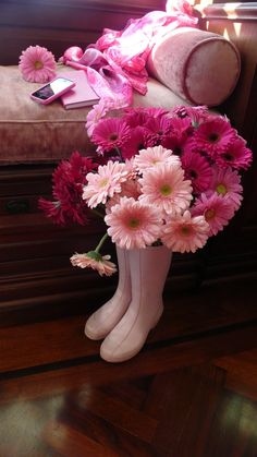 pink sofa, flowers & boots.