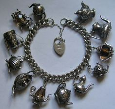 Vintage Sterling Silver English Teatime Charm Bracelet w 12 Tea Pots Vintage Charm Bracelet, Charm Jewelry, Vintage Jewelry, Fine Jewelry, Charm Bracelets, Geek Jewelry, Gothic Jewelry, Jewlery, Jewelry Necklaces