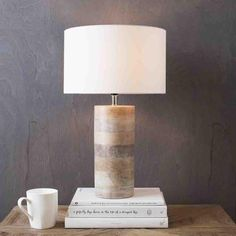 "Arbor Table Lamp Shade(Outside): Cotton, Body: Mango Wood Base Finish: Natural Finish Shade Color: White Shade Top Dimension: 11.81"" Shade Bottom Dimension: 11."