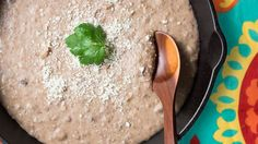 Prepare this refried beans recipe using beans, lard, onion and cheese. Get the recipe at PBS Food.