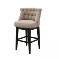 The Sora Swivel Bar Stool is where convenience meets sophisticated dramatic style. The Sora Collection makes a statement in style and size with fabric upholstered wings and a tufted back making these stools perfect around a bar table or counter.