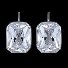 Silver earrings, CZ, rectangle Silver earrings, Ag 925/1000 - sterling silver. With stones (CZ - cubic zirconia). Dangle earring with closable clasp. Rectangle zircon set in silver. Dimensions approx. 9x12mm. Price per pair.