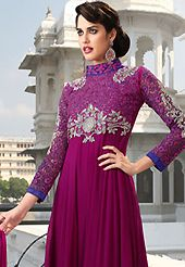 Dreamy variation on shape and forms compliment your style with tradition. The dazzling dark magenta faux georgette churidar suit have amazing embroidery patch work is done with resham, zari and stone work. Beautiful embroidery work on kameez is stunning. The entire ensemble makes an excellent wear. Matching santoon churidar and chiffon dupatta is available with this suit. Slight Color variations are possible due to differing screen and photograph resolutions.