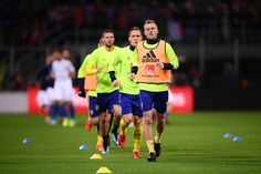 Sweden's midfielder Sebastian Larsson warms up with teammates prior the FIFA World Cup 2018 qualification football match between Italy and Sweden, on November 13, 2017 at the San Siro stadium in Milan. / AFP PHOTO / Marco BERTORELLO