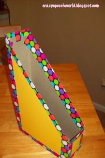 Folder storage made from cereal boxes.