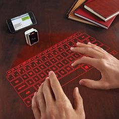 Virtual Keyboard From Brookstone / Tired of using your thumbs on minuscule smart phone and tablet keyboards? Spilled hot beverages and sticky stuff on a laptop keyboard? Forget all the keyboard pain with this virtual keyboard from Brookstone. Gadgets And Gizmos, Latest Gadgets, Unique Gadgets, Awesome Gadgets, Spy Gadgets, High Tech Gadgets, Cool Gadgets To Buy, Travel Gadgets, Cooking Gadgets