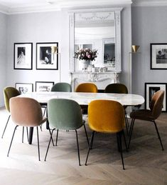 Different colored chairs accenting this dining space I Décor Aid