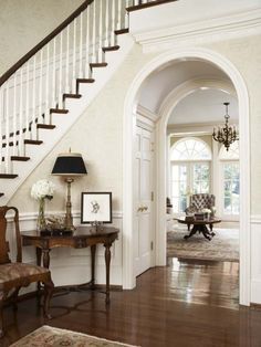 Arched doorways provide an elegant frame for closets and basement doors.