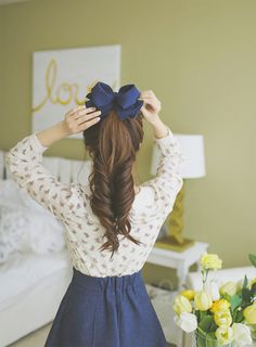How to make a simple ponytail look even better; split in half and curl the two sides into each other