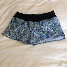 Nike dri fit running shorts, women's Brand new women's running shorts with back zip pocket.  Blue, green, white with black waist band Nike Shorts
