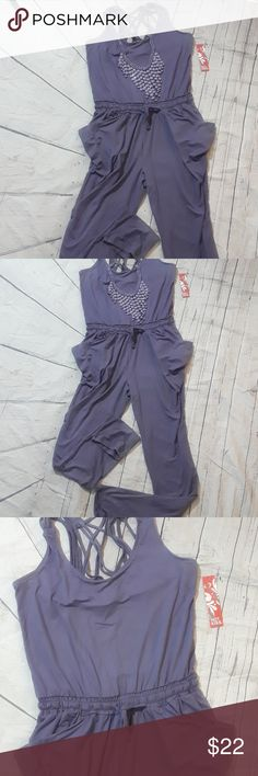 Hot Kiss Lavendar romper/jumpsuit skinny leg Beautiful jumpsuit brand new with tags. The jumpsuit has lots of detail including drawstring waist, side pockets, skinny leg and criss cross back.the jumpsuit is a soft stretchy material  bust is 20 inches, waist is 14 inches and inseam is 33 inches. Pants Jumpsuits & Rompers