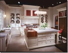 Christopher Peacock's Signature Collection, Chicago showroom. Check out the partial butcher block countertop, like the floor to ceiling cabinetry, x-frame cabinet doors and the really cool staggered crown molding.