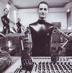 Kraftwerk. This was insanely creative and ahead of their time, when they introduced their robotic counterparts!