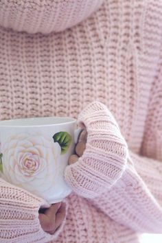 Yasmin Hakim keeps herself warm and cozy with a light pink mixed-stitch turtleneck sweater and a cup of hot tea | Banana Republic