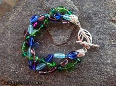 Take a look at our Stunung Glass Collection! Blue Purple & Green Glass Beads in a Braid Bracelet by CaliSunrise, $21.00