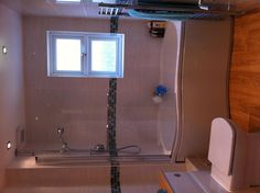A small en-suite with bath and shower