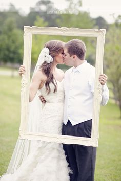Bring a simple white frame to your wedding photo shoot. Simple, elegant prop.