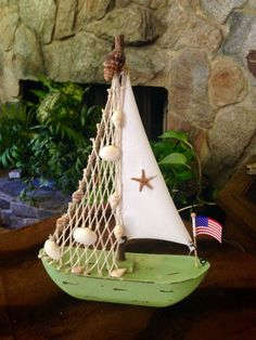 Sailboat With Sail, Cockle Shells, Starfish, and American Flag by BelleMistique on Etsy https://www.etsy.com/listing/228156563/sailboat-with-sail-cockle-shells