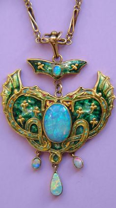 James Cromar Watt - A rare Arts and Crafts gold, silver, cloisonné enamel and opal pendant, circa 1900. Signed JCW for James Cromar Watt. #CromarWatt #ArtsAndCrafts #pendant