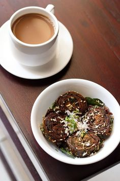 alu vadi recipe with step by step photos. alu vadi or patra is stuffed rolled colocasia leaves snack popular in maharashtrian and gujarati cuisine. alu vadi recipe is also known as pathrode.