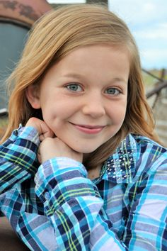 preteen photo shoot. Natural pageant head shot. SHe's won photogenic several times with this. I'm sure the dimple helps.
