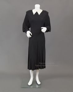 """Jean Muir. """"Black jersey dress with extended shoulders; keyhole neckline at back."""" ryerson-fashion-research-collection.com. """"FRC_EveDresses_2009.01.395_FRT_Web"""""""
