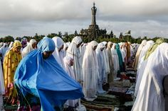 Muslims pray during mass to celebrate Eid-ul Fitr on July 17, 2015 in Denpasar, Bali, Indonesia. The two-day holiday, Eid ul-Fitr, marks the end of Ramadan, the Islamic month of fasting and begins after the sighting of a new crescent moon. (Putu Sayoga/Getty Images)