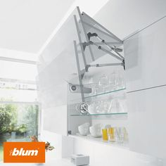 Blum's SERVO-DRIVE for AVENTOS – the perfect solution for functional, easy-to-use wall cabinets. With a light touch the cabinet front lifts up and out of the way automatically allowing optimal access to the cupboard interior.