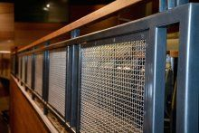 Banker Wire's S-9 metal fabric is used as infill for the space's railings.
