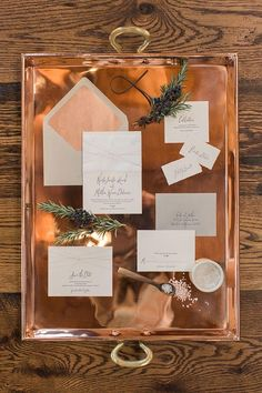 This neutral #wedding invitation suite really stands out on this gorgeous copper tray. See more of this metallic trend here: http://www.mywedding.com/articles/copper-wedding-details/